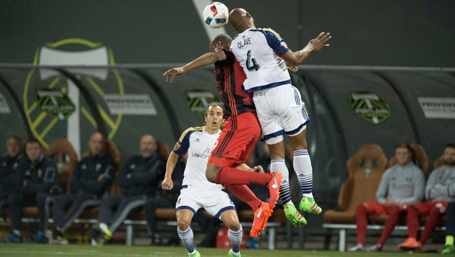 Portland Timbers forward Fanendo Adi (9) battles for a header against Real Salt Lake defender Jamison Olave (4) during the first half of an MLS soccer game at Providence Park in Portland, Ore., Saturday, March 19, 2016.
