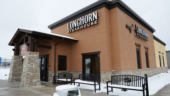Longhorn Steakhouse at South College Avenue and East Monroe Drive has pushed back its opening until Tuesday.