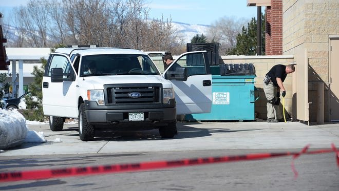 The Larimer County Coroner's Office and Fort Collins police investigate the circumstances surrounding a man's death outside a Discount Tire on North College Avenue on Thursday, March 24, 2016.