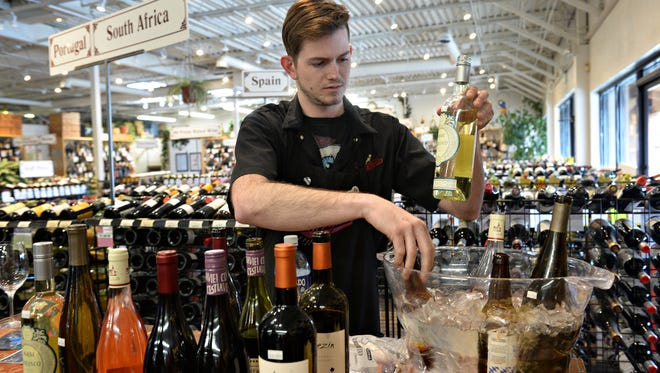 Joe Bauer works during a tasting at Pringle's Fine Wine and Spirits on Friday.