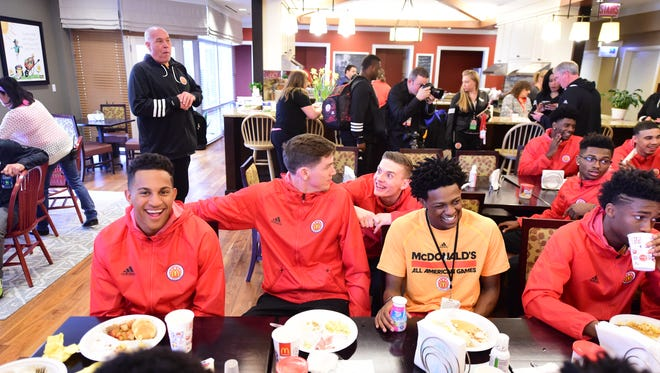 Incoming Kentucky freshman De'Aaron Fox (middle, in yellow) shares lunch with some of his fellow McDonald's All-Americans during a visit to the Ronald McDonald House.