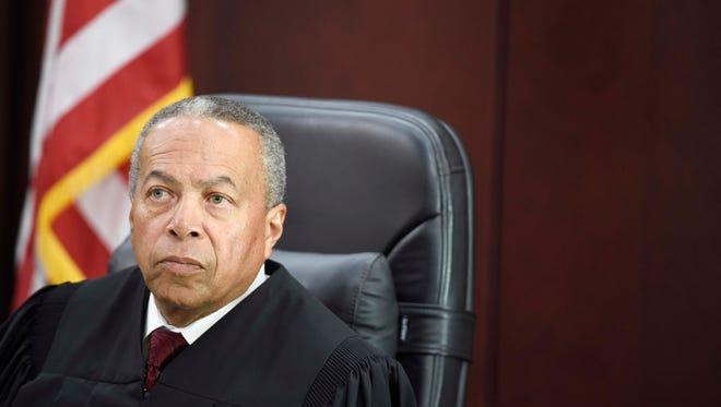 Judge Monte Watkins listens during the opening day of Cory Batey's trial.