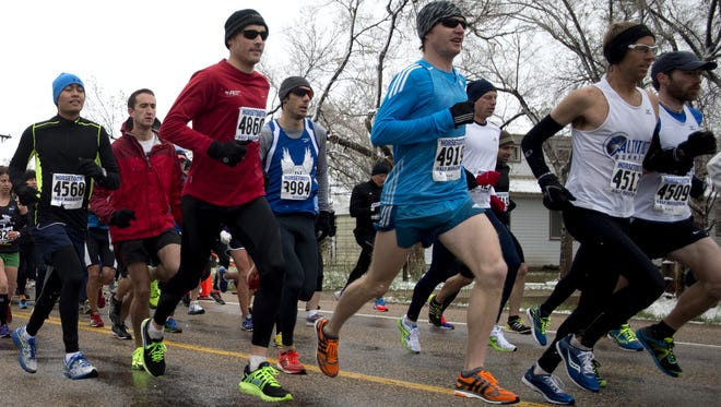 Michael Chavez, in blue, won the 2014 Horsetooth Half Marathon. He's among a panel of local runners sharing advice about how to run the half-marathon on Sunday.