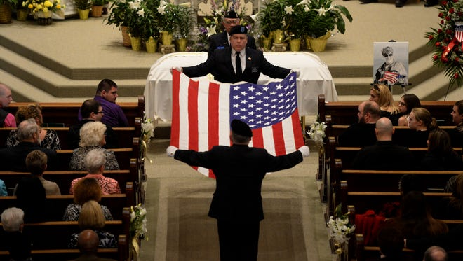 A flag is folded and presented to the family during the funeral for former Mayor Sally Hutton Tuesday, April 12, 2016 at St. Andrew Catholic Church in Richmond.