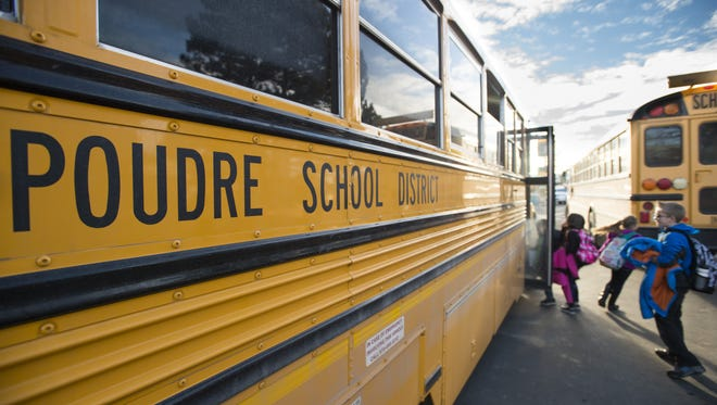 Students board a school bus to head home after a day at Tavelli Elementary School Jan. 26.