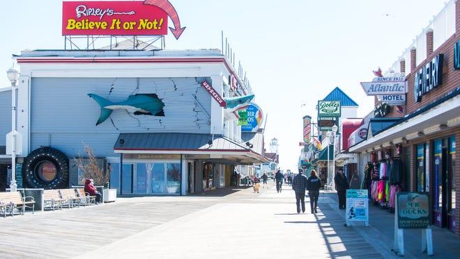 Visitors stroll the boardwalk on Thursday, April 14 in Ocean City.