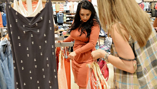 Sarah Dick shops at Buckle on Thursday, April 14, 2016.  Sales at Buckle in Foothills Mall have increased steadily since the opening of new stores at the mall. Increased sales and the addition of new clothing and accessory stores has helped boost sales tax collections for the city of Fort Collins.
