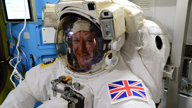 This NASA image obtained January 12, 2016, shows European Space Agency (ESA) astronaut Tim Peake (@astro_timpeake) as he shares this photo taken aboard the International Space Station on January 11, 2015, during preparations for a spacewalk, or extra-vehicular activity (EVA).