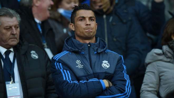 Real Madrid's Portuguese forward Cristiano Ronaldo stands in the crowd as a spectator during the UEFA Champions League semi-final first leg.