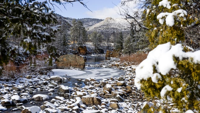 Snow covers the ground as the Poudre River flows through the Poudre Canyon Monday, Feb. 16, 2015.