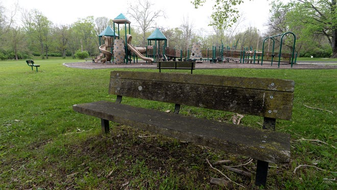 A bench near the playground at Springwood Park Thursday, May 5, 2016, in Richmond.