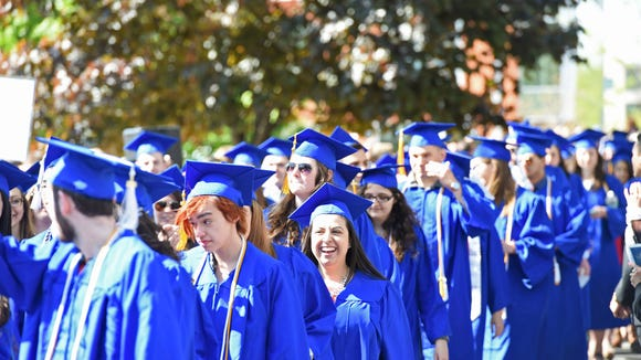 Candidates for graduation walk in for SUNY New Paltz's 2016 commencement ceremony .