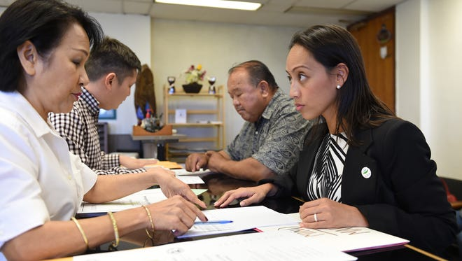 Regine Biscoe Lee picks up an application packet at the Guam Election Commission office in Anigua on Jan. 28. As of May 31, 43 candidates officially filed with the Guam Election Commission to run in Guam's upcoming elections.