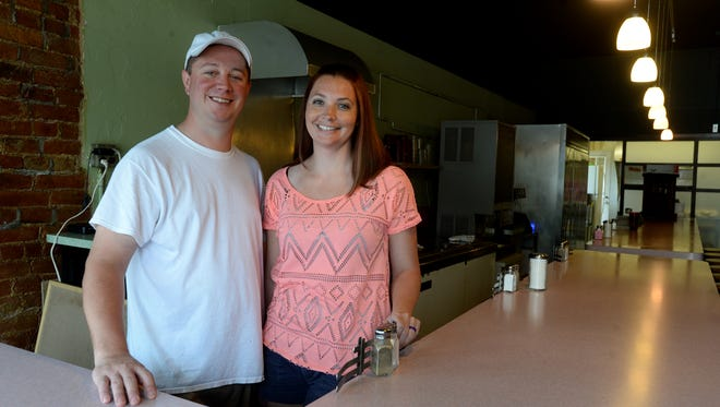 Owners Josh and Amanda Orbik Thursday, June 2, 2016, at the Main Street Diner which will reopen Friday as AJ's Diner on East Main Street in Richmond.