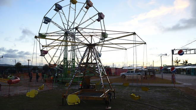 This file photo shows a ferris wheel at the Tiyan Liberation Carnival in June 2016. Some Guam residents have said casino-style gambling should be separated from the carnival's family-friendly activities.