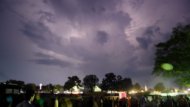 Lightning lights up the sky as the crowd is evacuated at the Bonnaroo Music and Arts Festival in Manchester, Tenn on Friday, June 10, 2016.