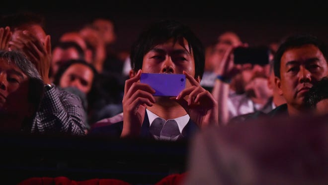 Spectators watch the Sony PlayStation E3 press conference at the Shrine Auditorium in Los Angeles June 13, 2016.