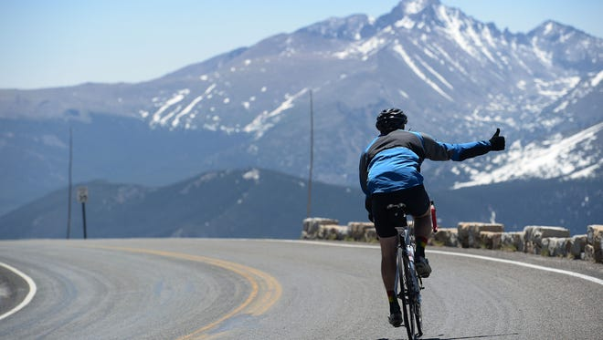 A cyclist rides Trail Ridge Road in Rocky Mountain National Park during the multiple day Ride the Rockies on Thursday, June 16, 2016.