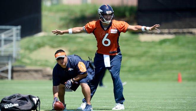 Jun 7, 2016; Englewood, CO, USA; Denver Broncos quarterback Mark Sanchez (6) during mini camp drills at the UCHealth Training Center.
