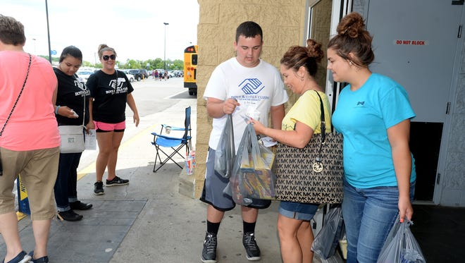 Communities in Schools, with help from members of the Boys & Girls Clubs of Wayne County, asks area residents to help Stuff the Bus with school supplies July 9 outside Walmart in Richmond.