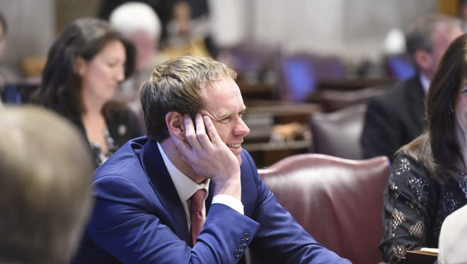 Rep. Jeremy Durham returns to the House chambers  at the Tennessee State Capitol Feb. 11, in Nashville, Tenn.