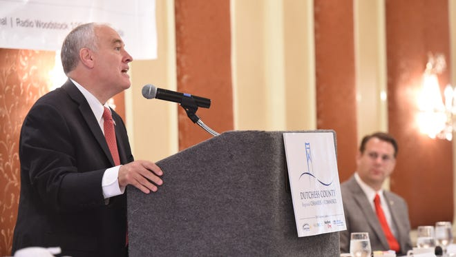 New York State Comptroller, Thomas DiNapoli, speaks as Dutchess County Regional Chamber of Commerce President, Frank Castella listens during Wednesday's Chamber breakfast at the Poughkeepsie Grand Hotel.