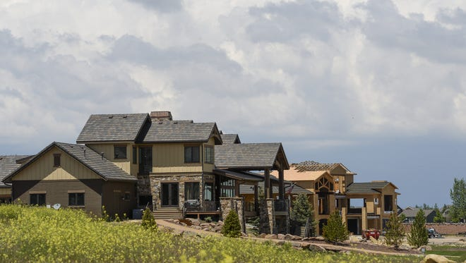 Under-construction homes in Windsor's Water Valley development are pictured in this 2014 file photo. Windsor has issued more building permits for new homes through June than Fort Collins has issued.
