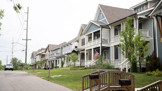 Recently built homes without large older trees on McEwen