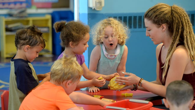 Gracie Rosson creates sculptures with students during summer camp at the Pauline Trueblood Childhood Development Center on the campus of Earlham College in Richmond. The preschool is part of Richmond Friends School, which is marking 45 years.