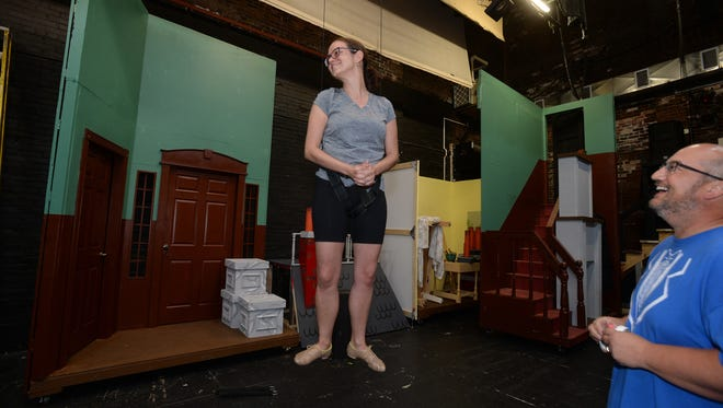 """Mike Day, right, watches as Shanna Camacho who plays """"Mary Poppins"""" takes her first flight Saturday, Aug. 6, 2016 for the Richmond Civic Theatre upcoming performance of """"Mary Poppins."""""""