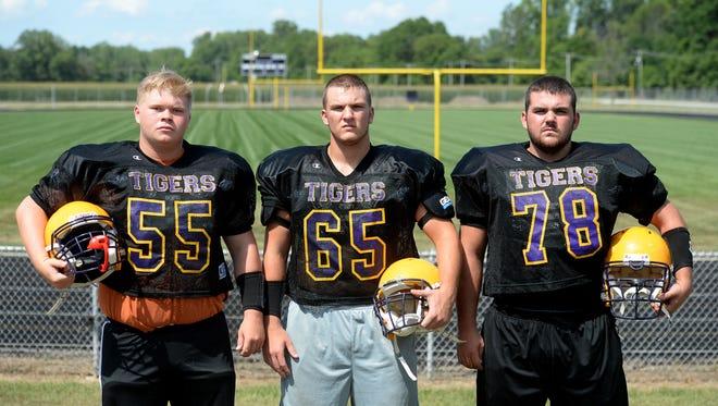 Hagerstown High School football offensive lineman Blake Blevins, left, Beau Wales and Keeton Adams.