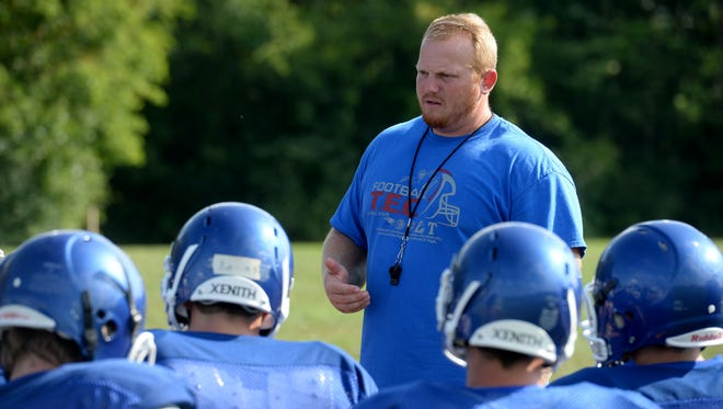 Centerville High School football Coach Kyle Padgett leads practice Friday, Aug. 5, 2016, in Centerville.