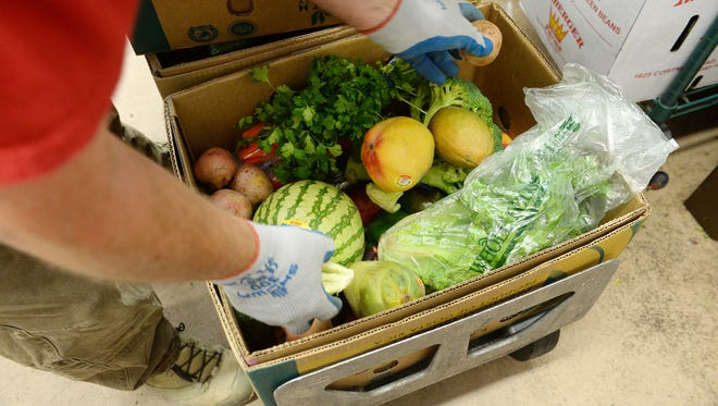 """Food Bank for Larimer County """"Rescue Ranger"""" Kyle Senger picks up unsellable food at Whole Foods on Wednesday, August 24, 2016. The food will be shared with agencies and directly with those in need."""