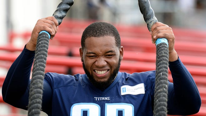 FILE -- In this Aug. 4, 2016 file photo, Tennessee Titans outside linebacker Kevin Dodd does a conditioning drill with heavy ropes during NFL football training camp in Nashville, Tenn. Dodd is looking forward to the opportunity to make his debut Saturday in a preseason game with the Oakland Raiders. The second-round pick from Clemson returned to practice last week after undergoing surgery on his right foot in May.(AP Photo/Mark Zaleski, File)