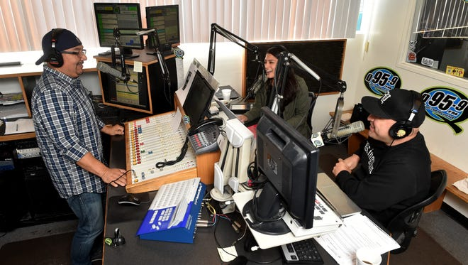 """Jaime """"Rico"""" Rangel (from left), Katherine """"Kat"""" Murrillo and Daniel """"Mambo"""" Herrejon share a laugh during a recent broadcast of the """"Rico and Mambo Morning Show."""" The Q95.9 FM radio co-hosts celebrate 20 years of working together on the air this month."""