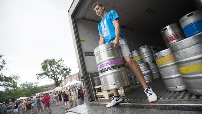 Volunteer Austin Bengford unloads a keg during the Colorado Brewers' Festival in Washington Park Saturday, June 25, 2016. Colorado's craft beer industry has reached a milestone $1.7 billion in direct economic impact, according to a University of Colorado study.