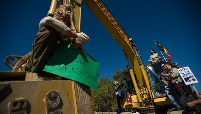 Protesters stopped work Tuesday, Sept. 13, 2016, at a worksite along Vermont Gas' pipeline project in New Haven.