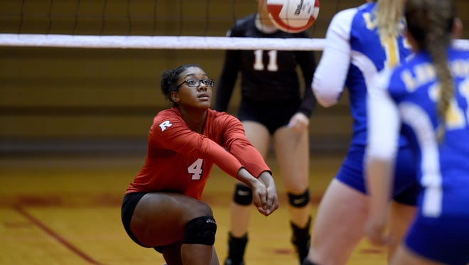 Richmond's Kaesha Bentley passes the ball against Lincoln Tuesday, Sept. 13, 2016 during a volleyball match at the Tiernan Center in Richmond.