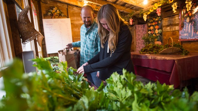 Customers pick out produce at a CSA farm in Fort Collins.