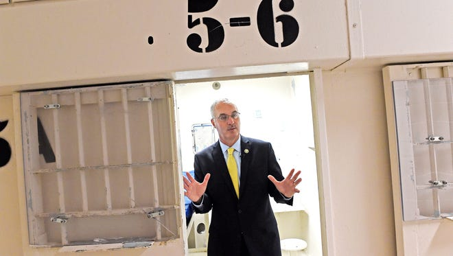 Sheriff Daron Hall stands inside one of  the cells where Perry March started to confide in — and plan homicides with — the guy in the cell next door.