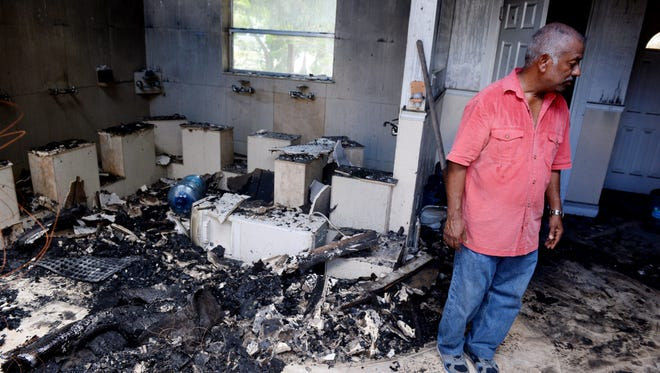 """Farhad Khan surveys the damage caused by a fire at the Islamic Center of Fort Pierce, Thursday, Sept. 15, 2016. A 32-year-old Port St. Lucie man, Joseph Michael Schreiber, who posted anti-Muslim sentiments on social media, is accused of causing the early Monday fire. """"I am not angry at (Schreiber) for doing this. I have forgiven him,"""" Khan said. """"I'm sad that the building has been ruined because this was a place for people to come pray and socialize."""" To see more photos, go to TCPalm.com."""