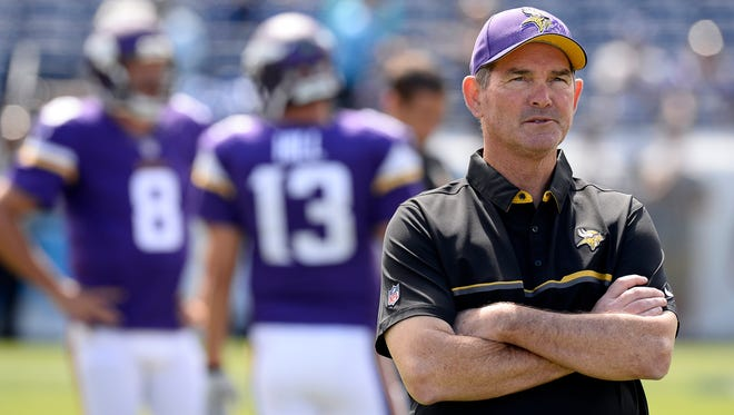 Minnesota Vikings head coach Mike Zimmer watches as players warm up before an NFL football game against the Tennessee Titans Sunday, Sept. 11, 2016, in Nashville, Tenn.