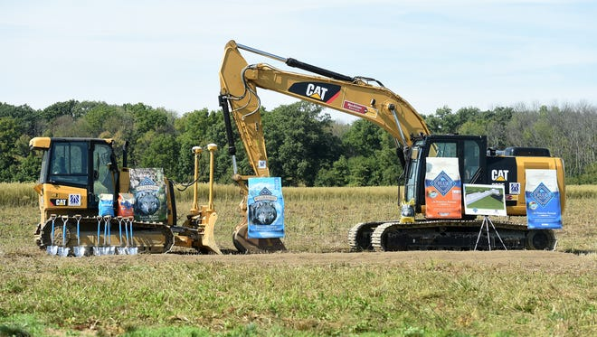 Officials attend a groundbreaking ceremony for Blue Buffalo, a pet food manufacturer, Thursday, Sept. 22, 2016 at Richmond's Midwest Industrial Park.