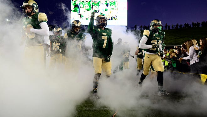 CSU players take the field for a night-game Nov. 14, 2015, at Hughes Stadium. The Rams' next three games will all be played late at night, with kickoff times of 8 p.m. and later.