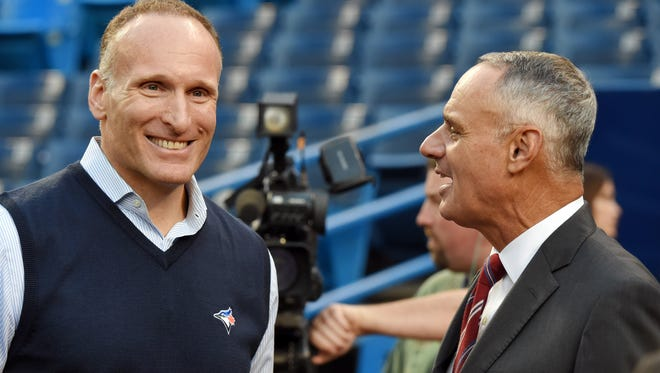 MLB commissioner Rob Manfred, chatting with Blue Jays president Mark Shapiro before Tuesday's wild card game, is concerned September rosters slow the pace of play.
