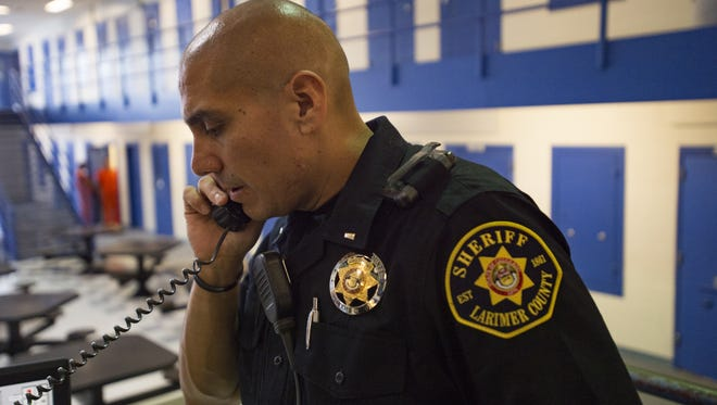 Lieutenant James Ramirez takes a call from an inmate housing area at Larimer County Jail Friday, September 30, 2016.