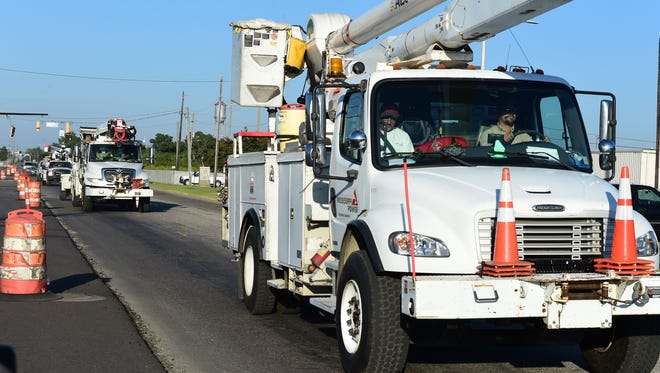 Trucks from Mississippi Power rolled out Saturday to help people in the Georgia and Florida areas without power.