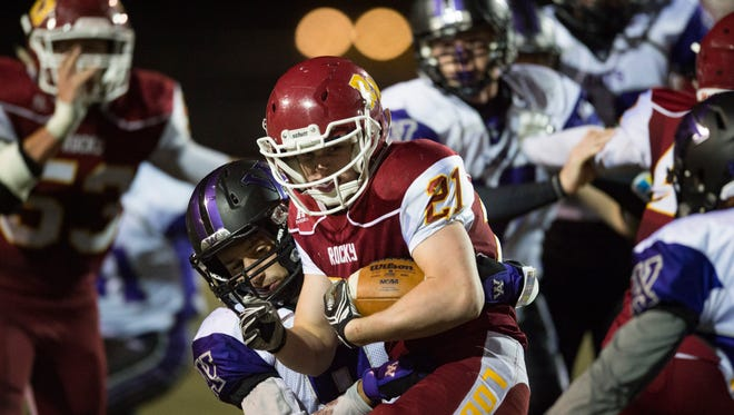 Ryan Hutcheson of Rocky Mountain High School is brought down by Arvada West defense during a game at French Field Thursday. The Lobos were defeated by the Wildcats 21-11.