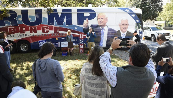 Sen. Jack Johnson and Williamson County Republican Party Chairman Julie Hannah address the crowd outside the Trump campaign bus, Friday October 21, 2016, in Franklin, Tennessee.