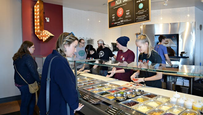 Jackie Krawietz, left, and Kaity Willis place their orders at Mod Pizza on Monday, October 24, 2016.